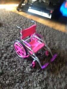 Toy wheel chair for doll.