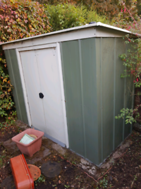 Pent roof shed with sliding door