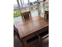 Oak extendable table & 4 oak/black chairs
