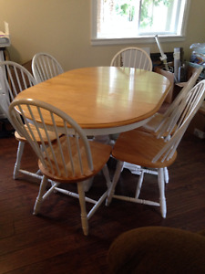 Oval pedestal table with six chairs