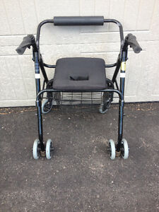 Wheeled walker with automatic brakes and seat