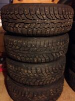 Four studded winter tires