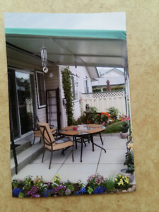 patio tables, chairs and awning