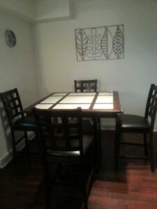 Leon's Dining room set: Bar style Dining table with 4 chairs
