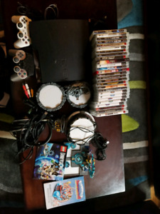 PS3+27 Games+Turtle Beach headset.