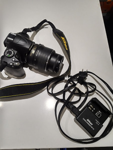 Nikon D3000 Almost New w/ charger+battery+SD Card