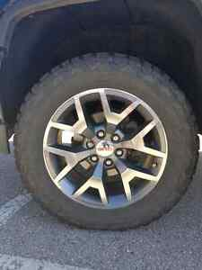 20 inch stock gmc rims and all terrain tires.
