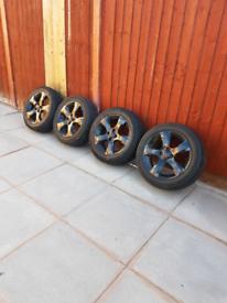 Black Vauxhall Corsa Alloys + wheels