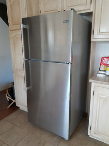 Maytag stainless steel refridgerator with top freezer