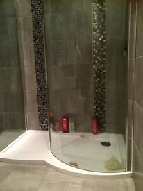 Shower tray and cubicle