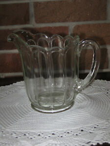 AN EXQUISITE OLD VINTAGE MID-SIZED PRESSED GLASS MILK JUG