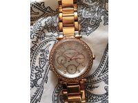 Women's rose gold Michael Kors watch