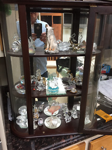cabinet with crystal figuers