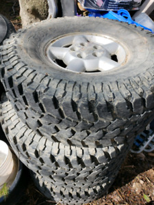 """**GREAT CONDITION 33"""" MUD OR STREET TIRES* CHEVY RIMS INCLUDED"""