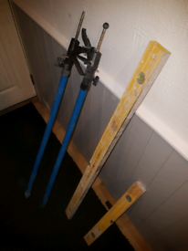 Extendable poles and spirit levels £20