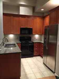 Kitchen cabinets and stove with microwave North Shore Greater Vancouver Area image 1