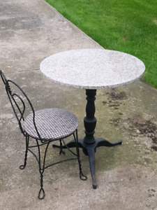 Marble top bistro cast iron table and two chairs