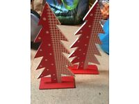 Matching red wooden Christmas trees