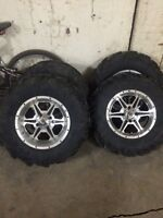 """14 inch ITP ss wheels with 2"""" spacers and  ITP XTR Mud Lit tires"""