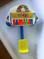 Toy piano with seat