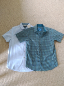 2 short sleeved shirts that are as new. One with tags on. Age 10-11