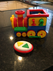 Remote control train that also sings songs (French and English)