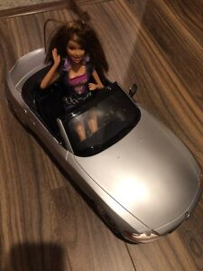 Barbie doll and car $7