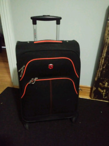 "Euc Swiss Gear Travel Luggage 20"" high . 4 wheel"
