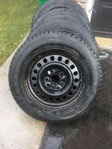 215 60 16 Bridgestone Blizzak WS80 winters on VW rims