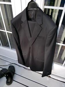 Young man.s black suit.