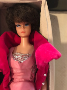 Vintage Barbie doll, clothes, case and more