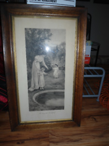 framed black & white print of lady standing by a pond