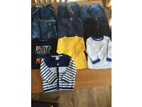 A bundle of 6-9 months jeans & tops great condition