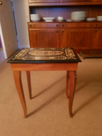 Small pretty decorated musical occasional table