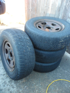 4 - 16 Inch rims and tires. Came off 2004 Jeep Liberty. $100.
