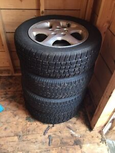 Studded Snow tires 205/60R16 with Rims 350$ obo