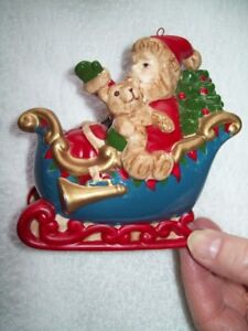POTTERY  SANTA IN SLEIGH CHRISTMAS TREE ORNAMENT