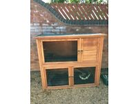 Two tier rabbit hutch plus bundle of toys and large bag of sawdust