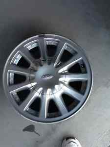 215/70/15 Bridgestone Winter Tires & 15x6.5 Ford Alloy Rims Belleville Belleville Area image 2