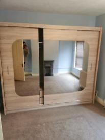 Wardrobe with mirror sliding doors