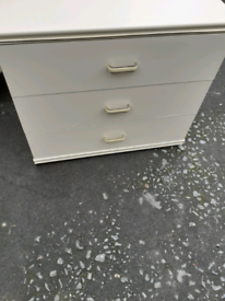Chest of drawers and two bedsides