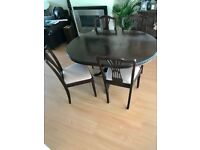 Dark wood antique table and 4 chairs