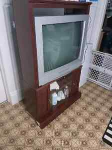 $50 takes TV and corner TV Stand.