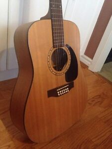 Simon and Patrick Luther 12 string acoustic guitar