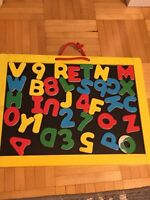Magnetic alphabet and dry erase board in one