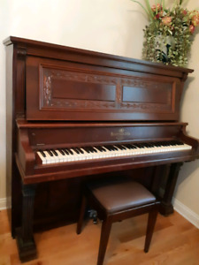 Antique piano with ivory keys