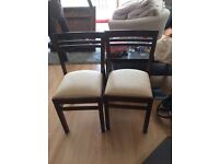 Two dark wood dinning chairs