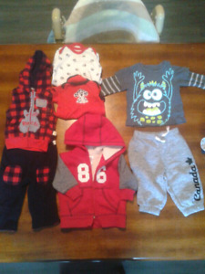 48 pieces of baby clothing from 0-18 months.