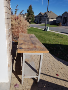 Heavy duty work bench with hardwood top.