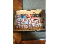 Children's train track set with train and carriage.